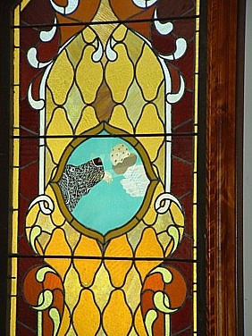 one of the stained glass windows featuring a dog